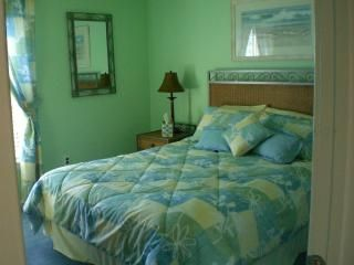 Upstairs queen bedroom w ocean & boardwalk views, flat screen tv and ceiling fan