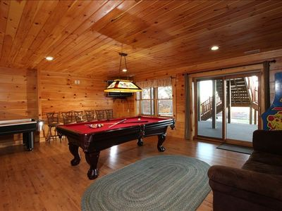 "Game room - pool table, air hockey, arcade game, 42"" LCD TV & queen sleeper sofa"