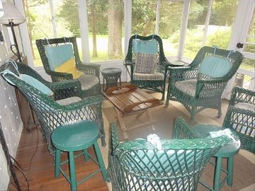 Screened-in porch opening onto backyard.