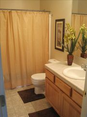 Eagle Crest house photo - Tommy Bahama (downstairs master) themed bathroom.