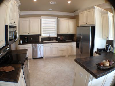 VERY Fully Furnished Kitchen. New SS Appliances. Kitchen Table seats 8.