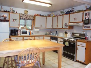 Windham house photo - spacious kitchen area with farm table