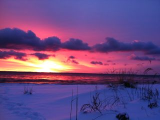 Northport cottage photo - An un-doctored shot of sunrise from our beach. Purple Snow! Dec. 2011.