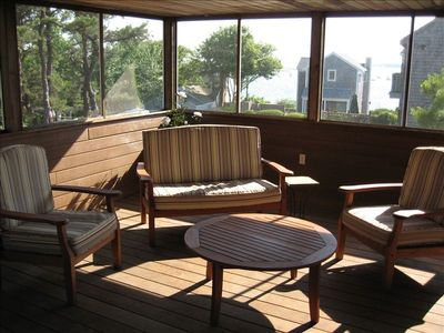 Spacious Screened in Porch with cedar decking, access to outdoor shower