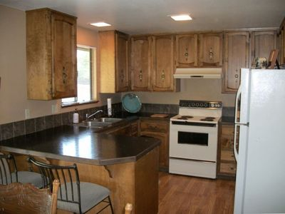 Kitchen is fully stocked and blends with dining and great rooms