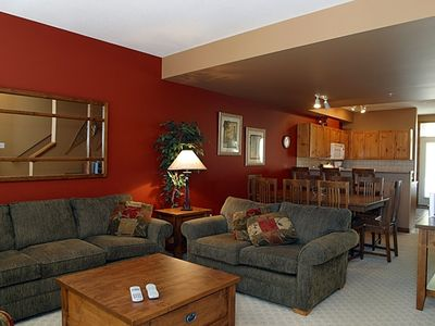 Spacious living room, dining room & kitchen. Back door to private hot tub, patio