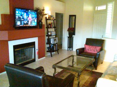Living room with leather chairs and 42 inch flat-screen TV with HD programing.