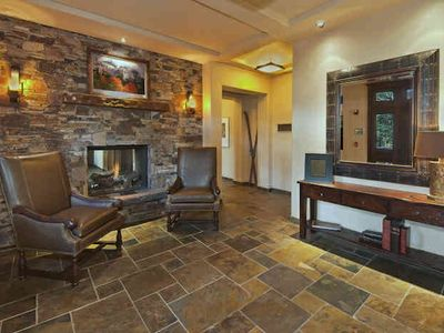Comfortable lobby with fireplace and ski lockers around the corner.