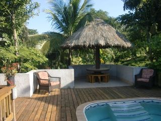 Roatan house photo - Palapa Table on newly enlarged pool deck