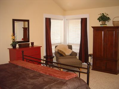 2nd view: King Master Suite #1.  Flat screen TV and DVD are located in armoire.