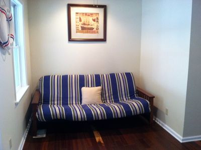 Queen futon in foyer area.