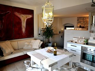 Modica house photo - The living-kitchen with artworks by the owner & artis Luca Giannini