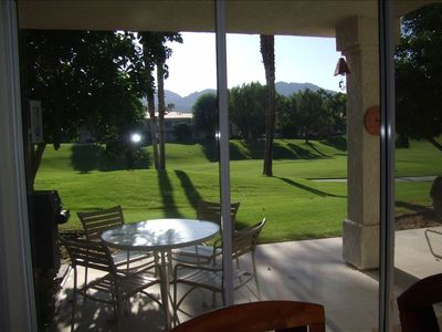View of the patio, fairway and Santa Rosa Mountains from the dining room