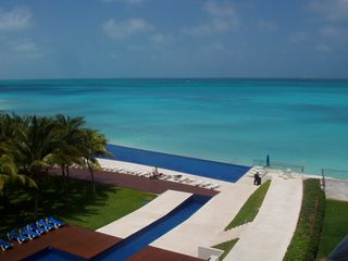 Cancun condo photo - View from Terrace with infinity pool and lap pool