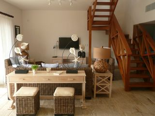 Las Terrenas condo photo - Living area with A/C and stairs to roof terrace.