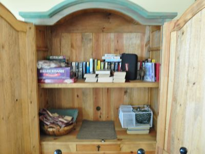 Take one-leave one lending library & family games in the DR armoire.