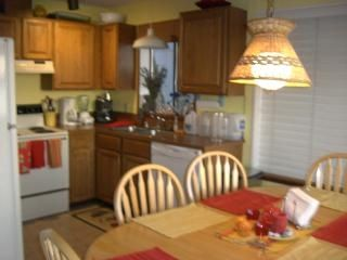 Fully stocked country kitchen with wide open view of beach and Puget Sound