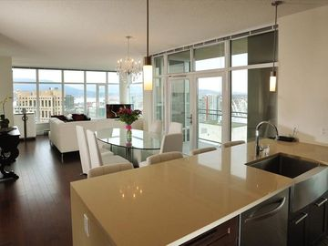 Open floor plan - kitchen, dining, living, balcony and view!