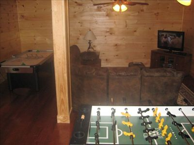 Basement / Gameroom with air hockey, fooseball, sleeper couch, television/dvd