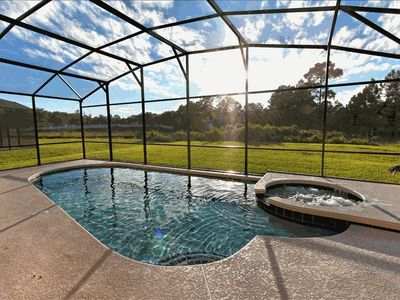 Heated pool & spa with gorgeous conservation view! Six chaise lounges not shown.