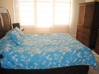 Isla Verde apartment photo - The bedroom, also with ocean view and a walking closet.