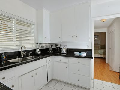 Fully equipped kitchen accented with granite counters