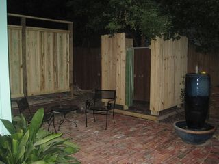 Ocean Springs cottage photo - Private outdoor seating area for Lagniappe Cottage, includes an outdoor shower.