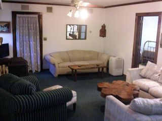 Moultonborough cottage photo - very spacious LR with flat screen and wrap around sectional and queen sleeper