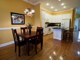 Folly Beach townhome photo - Dining area and kitchen - extra island seating as well as expandable table