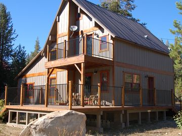 Soda Springs cabin rental - Cabin Exterior-View of Lake from top deck.