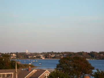 Views across Oyster Pond to Chatham village, church steeples, town beach
