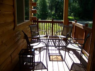 Houston cabin photo - Lots of seating on the front porch to watch the great outdoors.