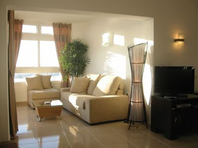 Extended lounge area with Estepona Marina views
