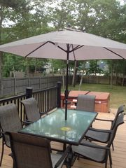 Hampton Bays house photo - Outdoor dining area with BBQ.