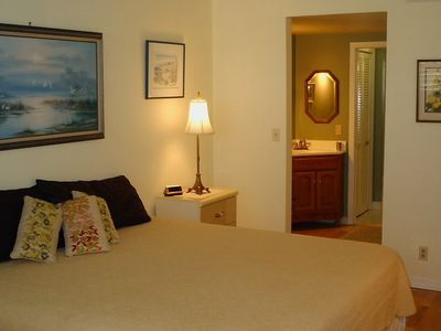 King size bedroom with private dressing area and lanai access.