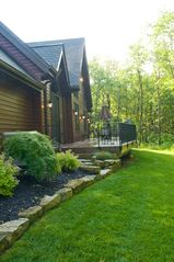 Seven Springs house photo - Rear deck spans kitchen, great room and master bedroom. Gas grill