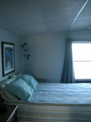 Freeport cottage photo - Master bedroom with window to the ocean. Queen size bed