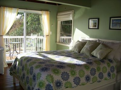 master bedroom with private deck  with bistro table. Great view Coral Bay!