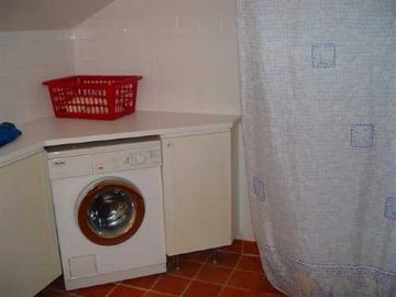 washing machine in main bathroom