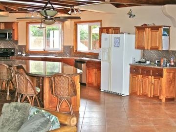 Portion of Huge Kitchen w 16 Ft. Granite Island!