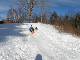 Wardsboro farmhouse photo - sledding in the back yard