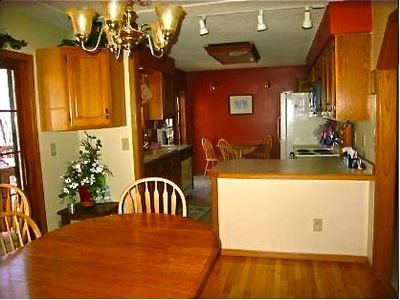 Detroit Lakes house rental - A cozy kitchen for family to gather after a long day of sun and lake activities