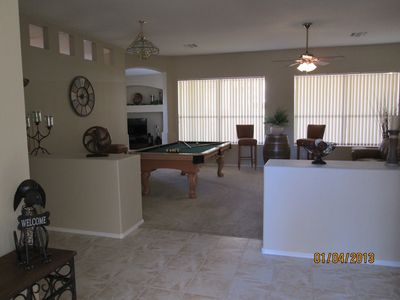 Wide Open Entry To Great Room w/Pool Table and great view of pool in backyard