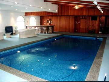 Three Rivers estate rental - Enjoy Your Family and Friends in the Indoor Pool with Sauna, Hot Tub, and Bar!