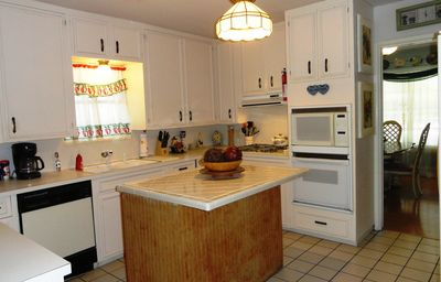 The kitchen has a gas stove top, built in electric oven and microwave.