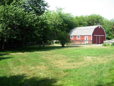 West Dennis house rental - The Old Red Barn and back lawn. . No neighbors back there either, just woods!