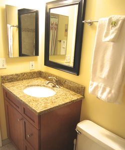 All new granite countertop, tile, mirror and cabinet with plenty of storage
