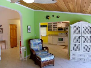 Sanibel Island house photo - Bright and colorful Florida Room that leads to the screen enclosed porch