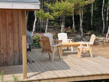 Private deck with wood furniture and propane bbq