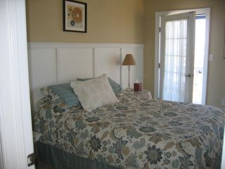 front bedroom with private balcony and window seat - Beach Haven townhome vacation rental photo